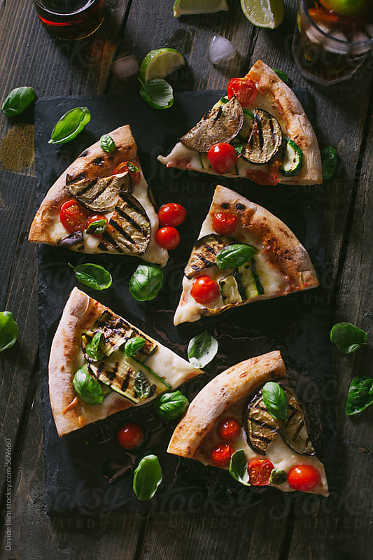 Italian pizza with mixed vegetables by Davide Illini for Stocksy United