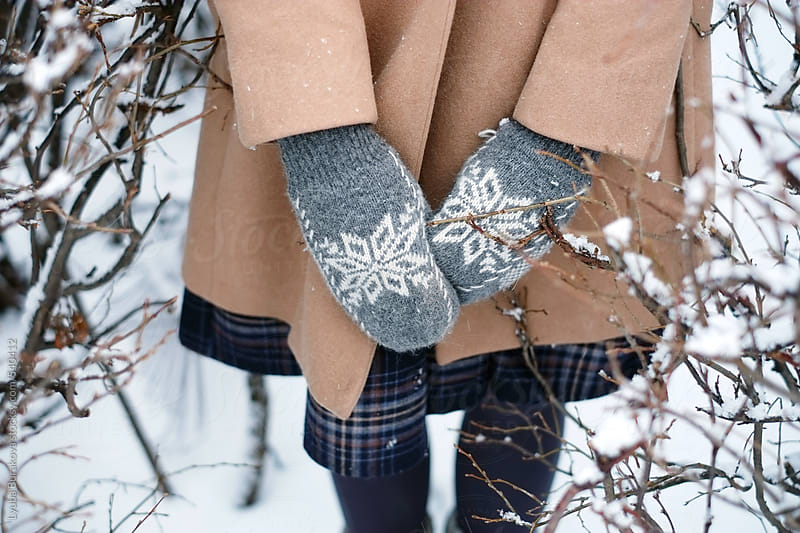 Close up shot of the woman's hands in mittens  by Lyuba Burakova for Stocksy United
