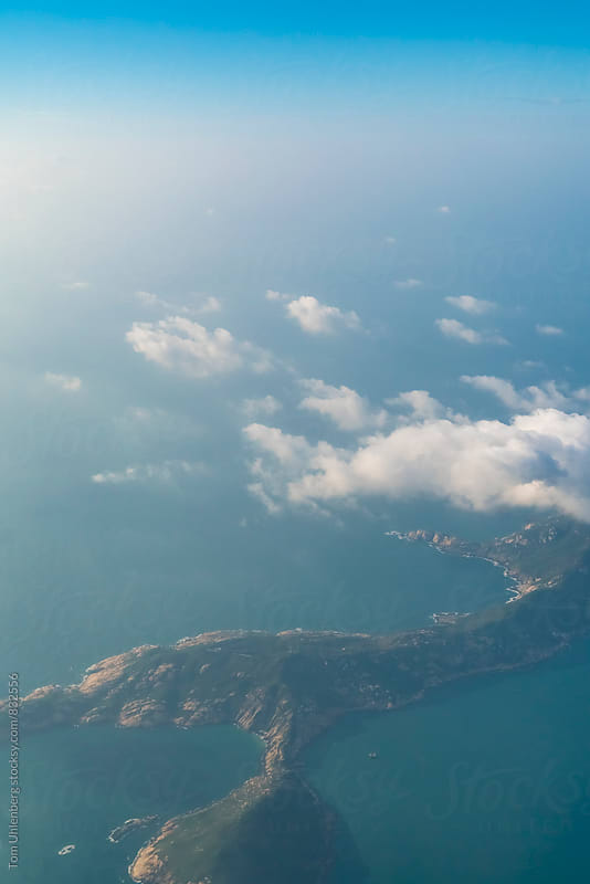 Approaching Hong Kong by Plane - A Small Island in the South China Sea by Tom Uhlenberg for Stocksy United