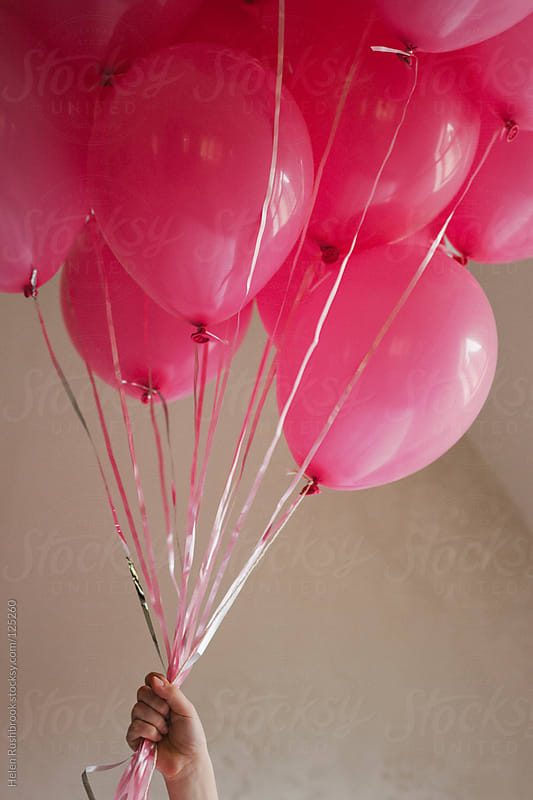 Pink balloons by Helen Rushbrook for Stocksy United