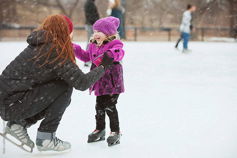 Skating: Mother Supports Little Girl While Skating by Sean Locke for Stocksy United