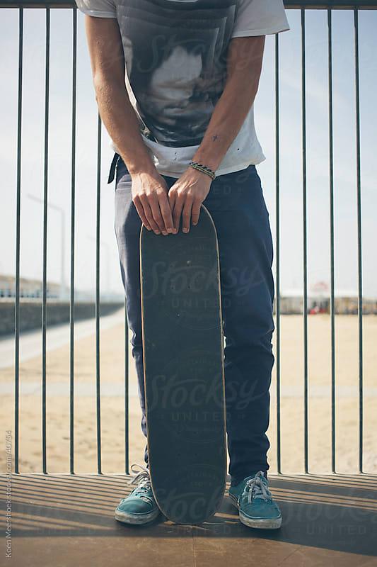 Skater holding his skateboard by Koen Meershoek for Stocksy United