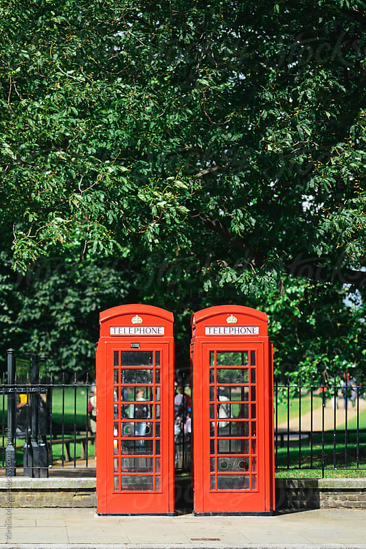 Red telephone boxes in London by Kirstin Mckee for Stocksy United