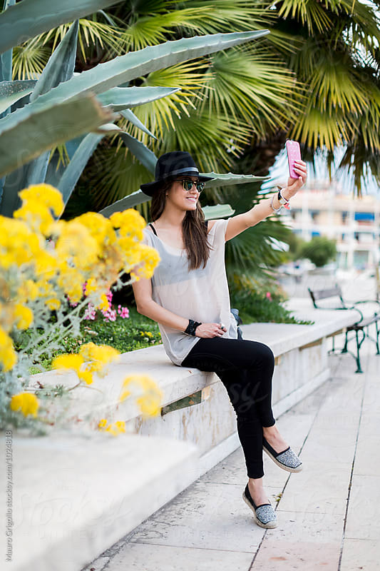 Woman taking a selfie by Mauro Grigollo for Stocksy United