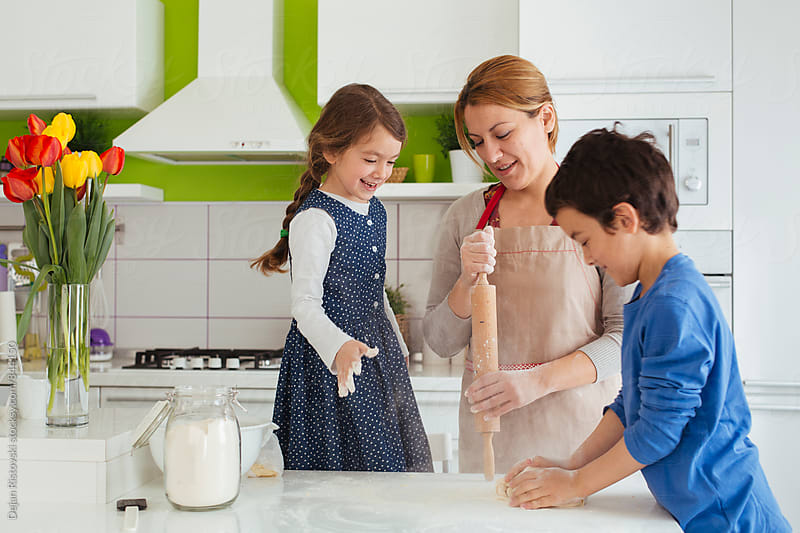 Family making cookies. by Dejan Ristovski for Stocksy United
