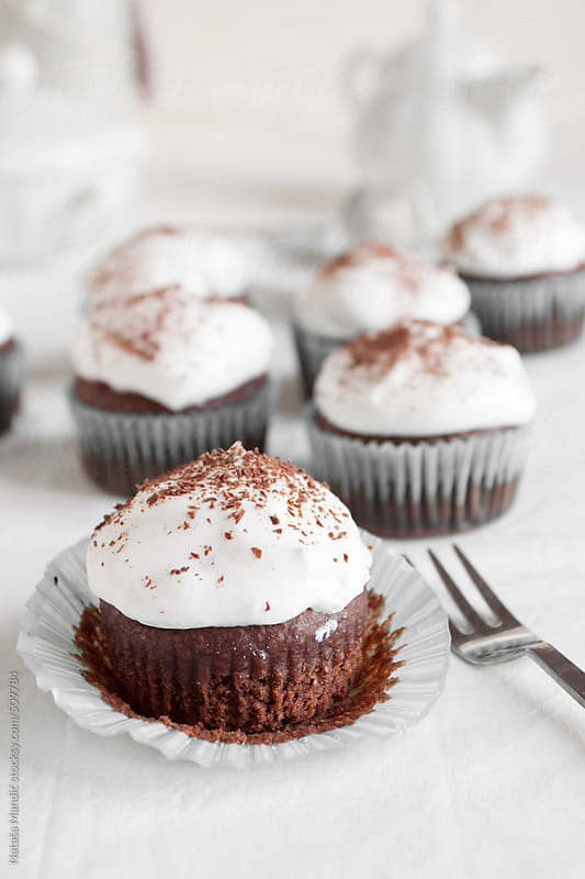 Chocolate cupcakes with creamy frosting by Nataša Mandić for Stocksy United