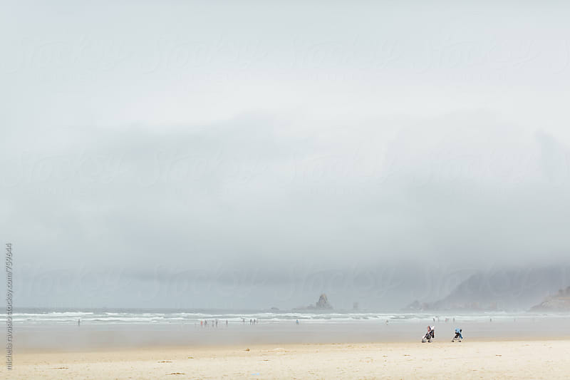 Two strollers on the beach in a cloudy day by michela ravasio for Stocksy United