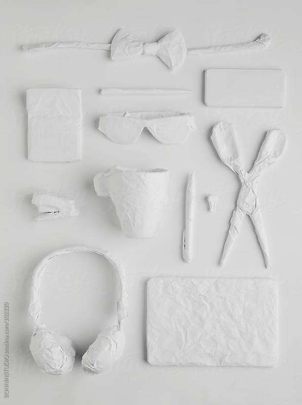 Composition of the content of business desk. Papered objects. White over white. by BONNINSTUDIO for Stocksy United