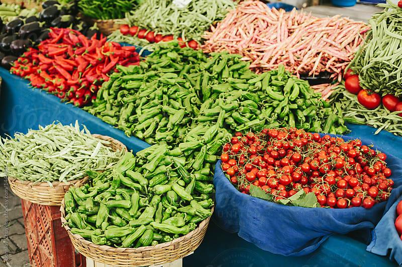 Stall of fresh vegetables on the market by Borislav Zhuykov for Stocksy United