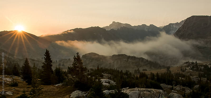 Sunrise and fog in the mountains of Wyoming by Mick Follari for Stocksy United