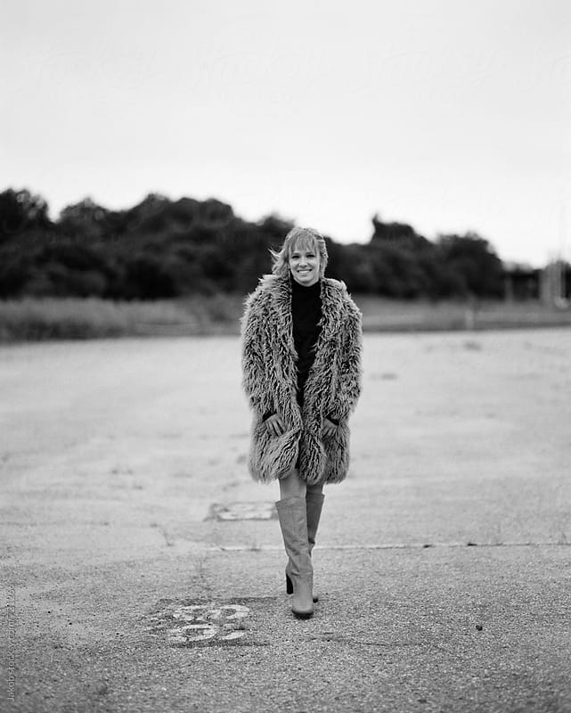 Black and white portrait of a beautiful young woman in a shag coat by Jakob for Stocksy United