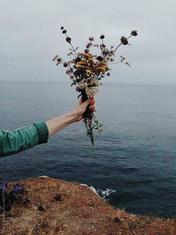 Holding Flowers Over the Sea by Kevin Russ for Stocksy United