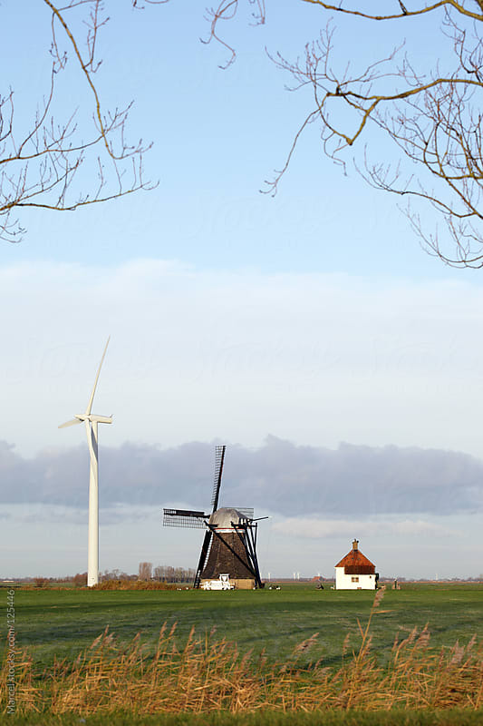 Old and new windmill by Marcel for Stocksy United