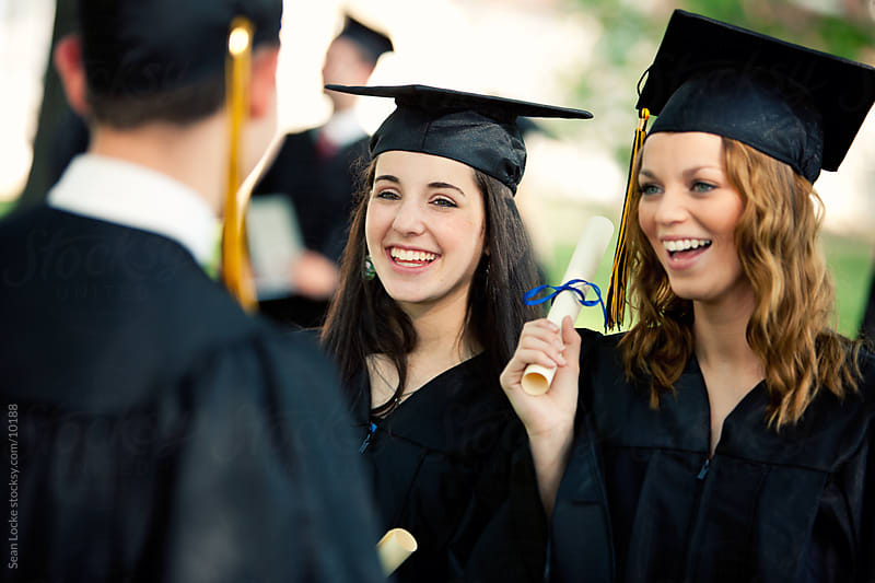 Graduation: Girls Talking To Guy Friend After Graduating by Sean Locke for Stocksy United
