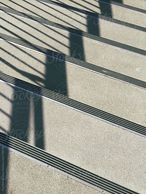 Modern concrete steps and shadows by Paul Edmondson for Stocksy United