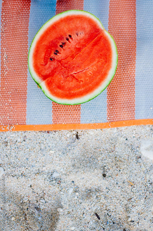 Fresh watermelon on a beach by Boris Jovanovic for Stocksy United