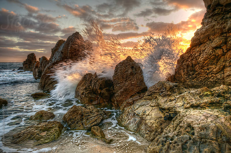 Crashing wave on rocks by Neil Kremer for Stocksy United