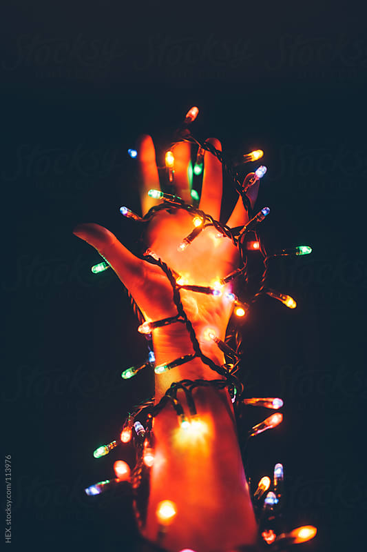 Twisted Christmas Lights on Arm by HEX. for Stocksy United