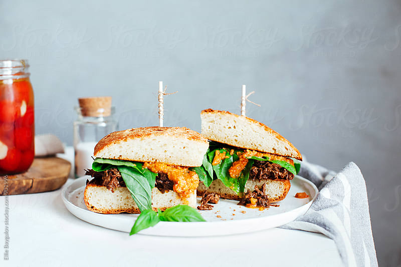 Braised beef short rib sandwich by Ellie Baygulov for Stocksy United