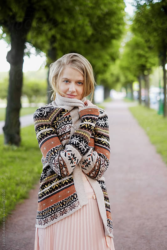 Blonde woman wrapped in a sweater by Lyuba Burakova for Stocksy United