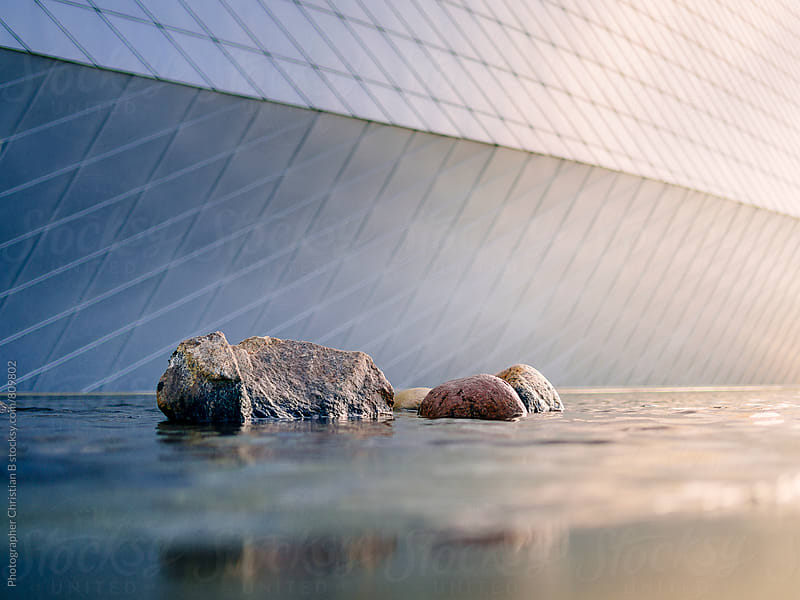 Rocks in water by Photographer Christian B for Stocksy United