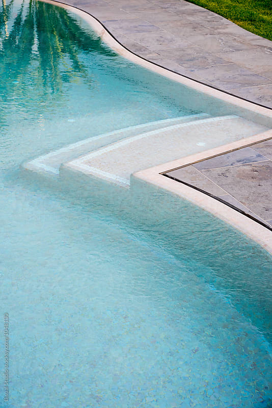 Stairs on a swimming pool by Bisual Studio for Stocksy United