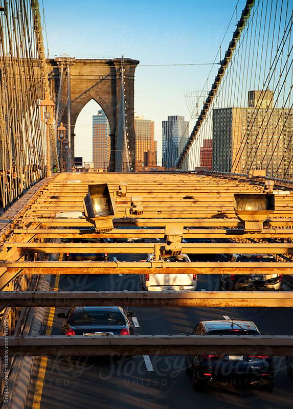 new york city traffic below the brooklyn bridge by Sonja Lekovic for Stocksy United