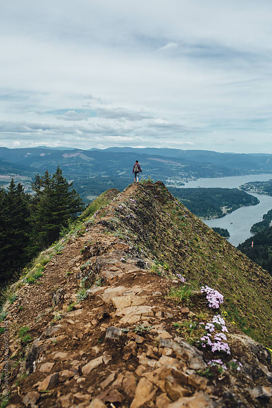 Woman Hiker Standing on Mountain Cliff by Evan Dalen for Stocksy United