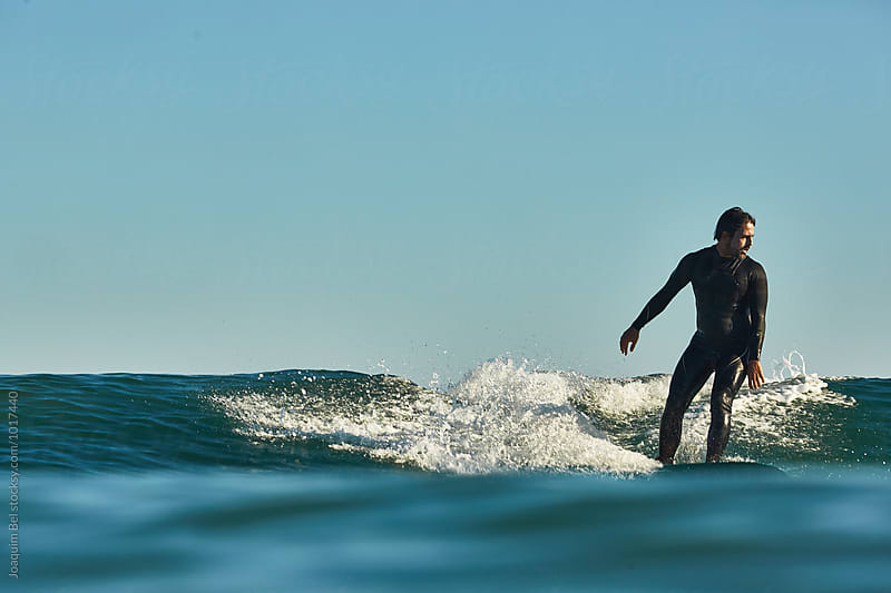 Surfing a mellow wave. by Joaquim Bel for Stocksy United