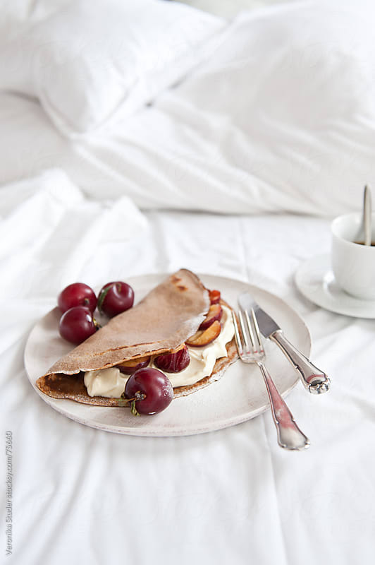 Pancake in bed by Veronika Studer for Stocksy United