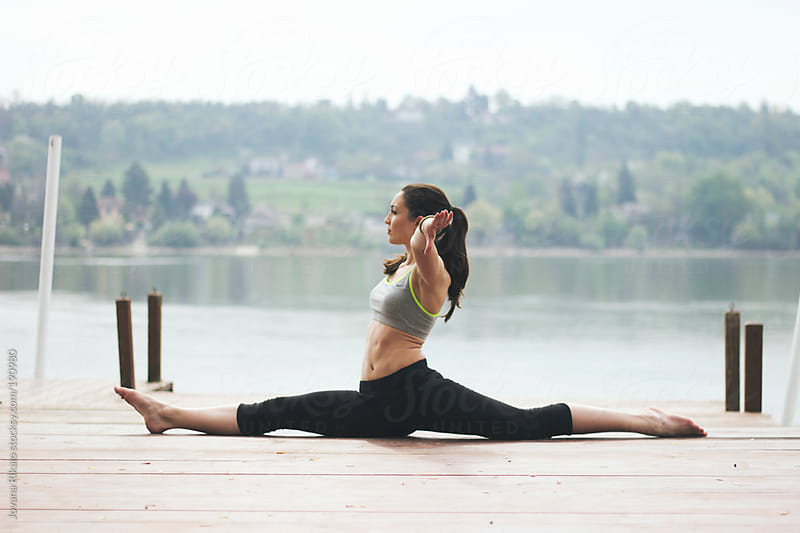 Young woman practicing yoga in nature by Jovana Rikalo for Stocksy United