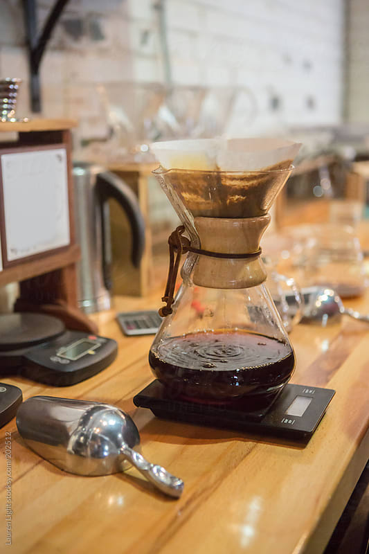 Precision brewing of gourmet coffee using pour over method  by Lauren Light for Stocksy United