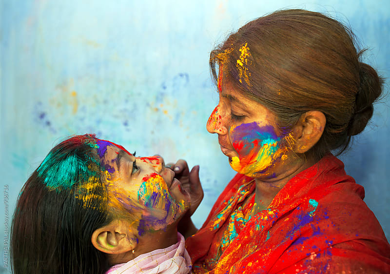 Mother with her daughter,both with colorful face by PARTHA PAL for Stocksy United