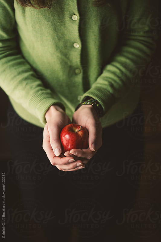 Apple in Hands by Gabriel (Gabi) Bucataru for Stocksy United