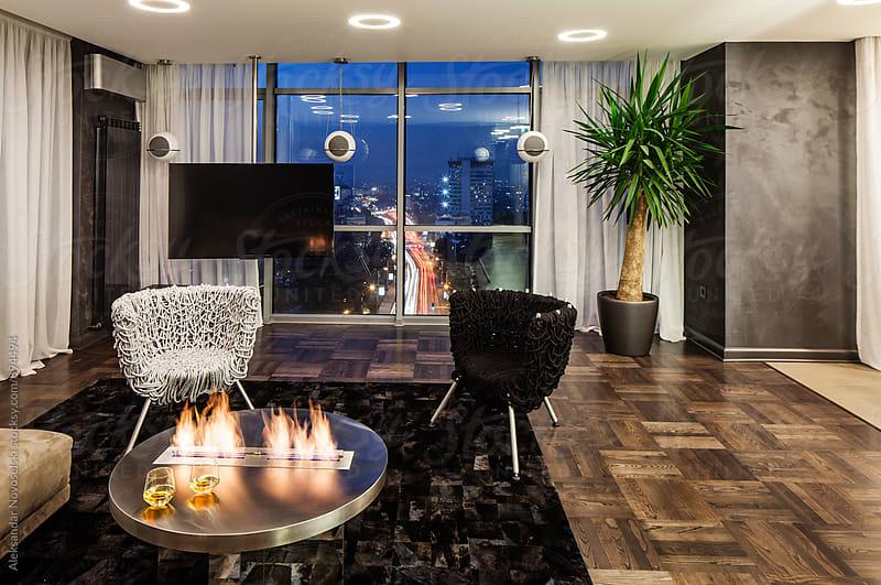 Living room in contemporary interior by night by Aleksandar Novoselski for Stocksy United