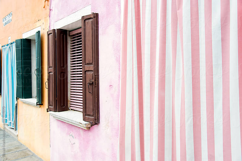 Colorful facades in Burano by Bisual Studio for Stocksy United