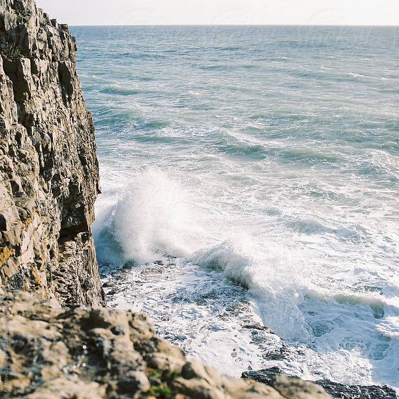 Waves crashing against cliffs by Andrew Spencer for Stocksy United