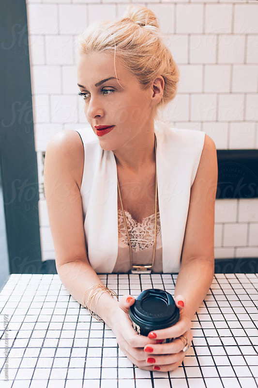 Woman Holding a Coffee Mug by Lumina for Stocksy United