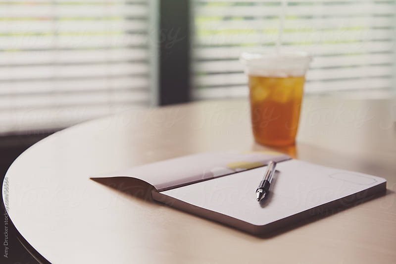 Empty Notebook with Iced Tea on a Table by Amy Drucker for Stocksy United