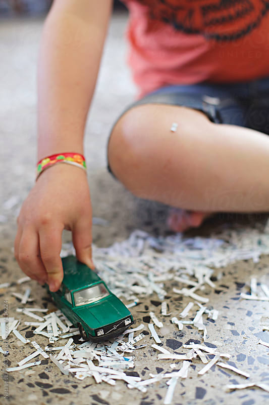 close up of boy playing with toy car by Natalie JEFFCOTT for Stocksy United