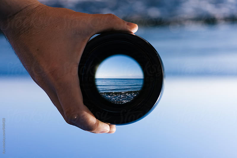 View through spyglass lens to the horizon above the water by Ilya for Stocksy United