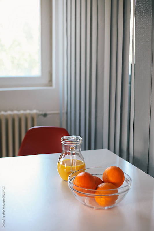 Orange juice and oranges on a table  by Marija Mandic for Stocksy United