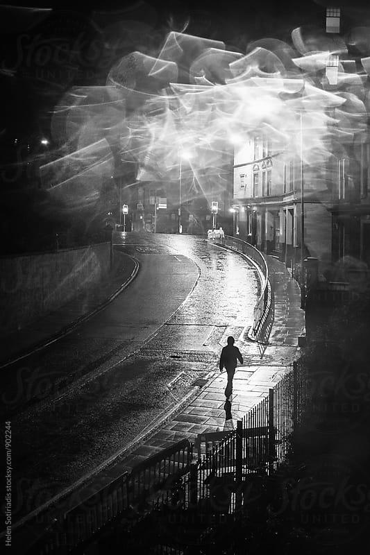 Walking on a Rainy Edinburgh Street at Night by Helen Sotiriadis for Stocksy United