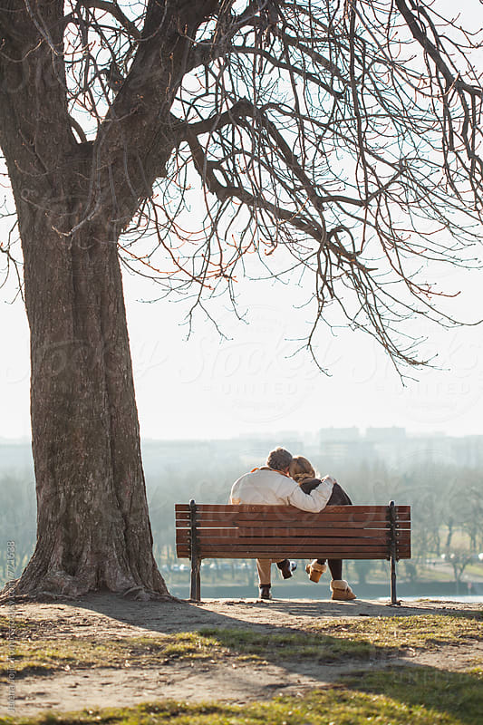 Senior couple sitting at the park by Jelena Jojic Tomic for Stocksy United