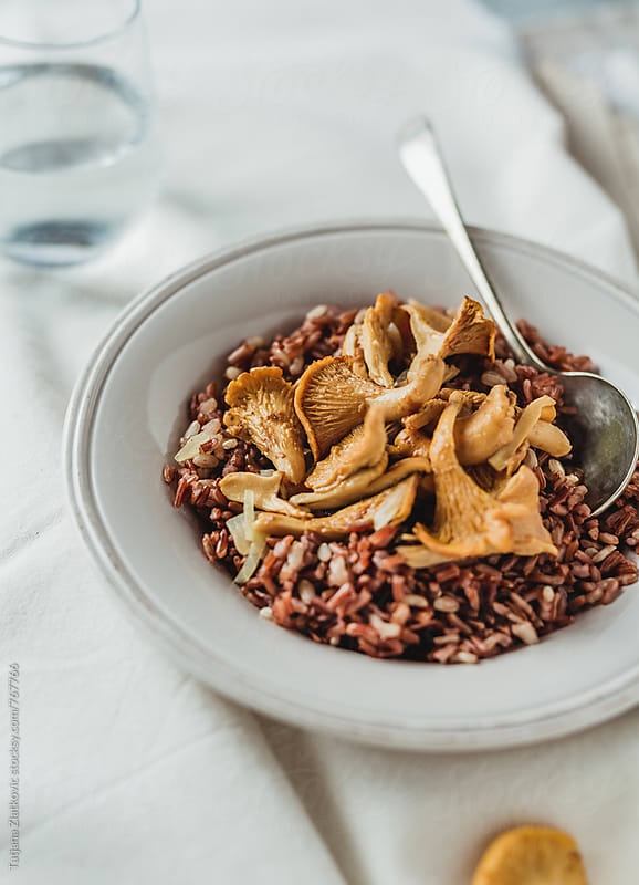Wild rice with chanterelle mushrooms by Tatjana Ristanic for Stocksy United