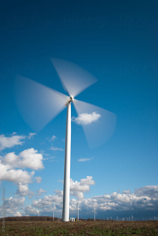 Industrial Wind Turbine Green Energy Generation on Wind Farm With Clear Blue Sky Ontario Canada by JP Danko for Stocksy United