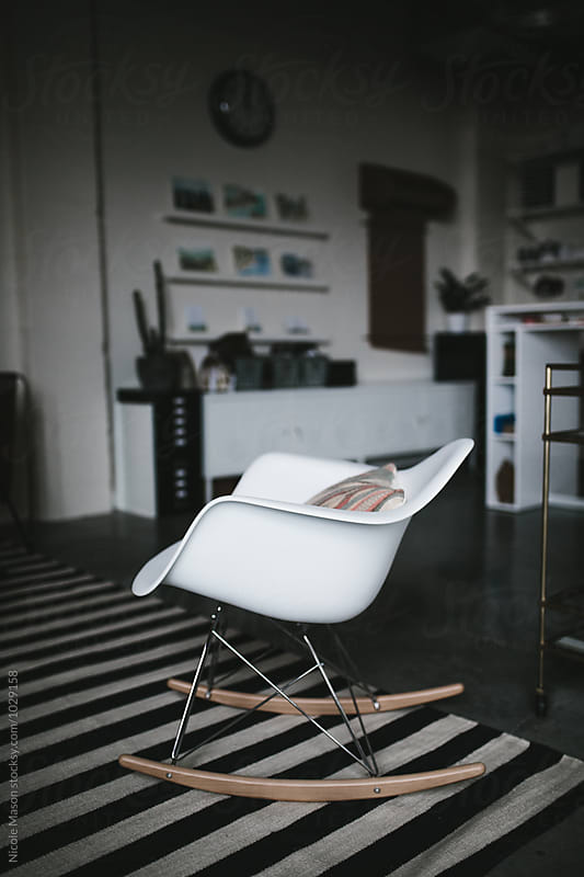 modern chair in creative office space by Nicole Mason for Stocksy United