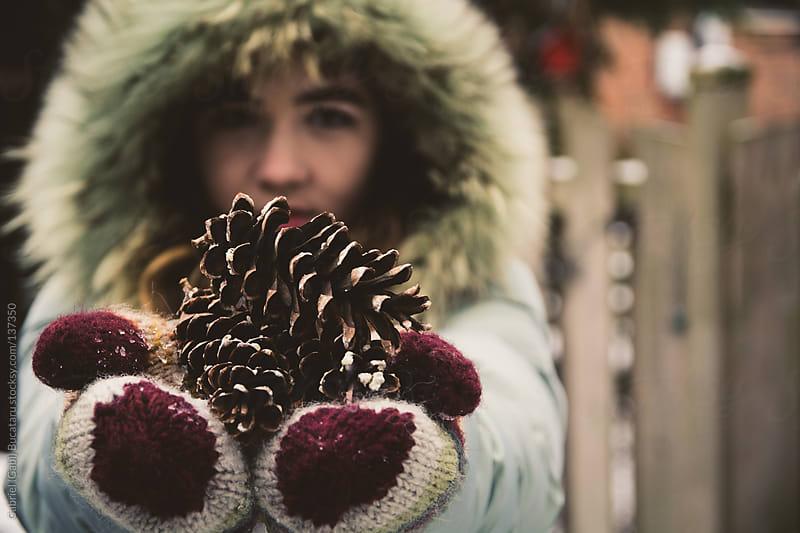 Girl with Pinecones by Gabriel (Gabi) Bucataru for Stocksy United