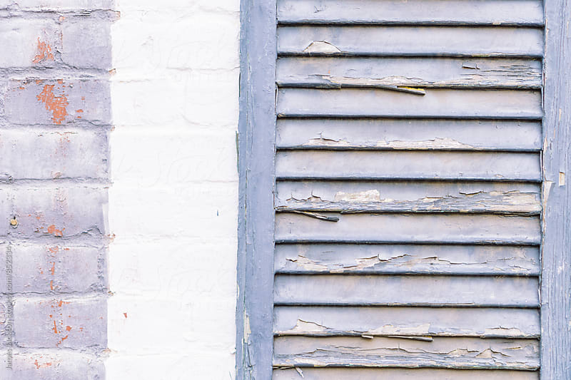 Weathered lavender shutter. by James Jackson for Stocksy United