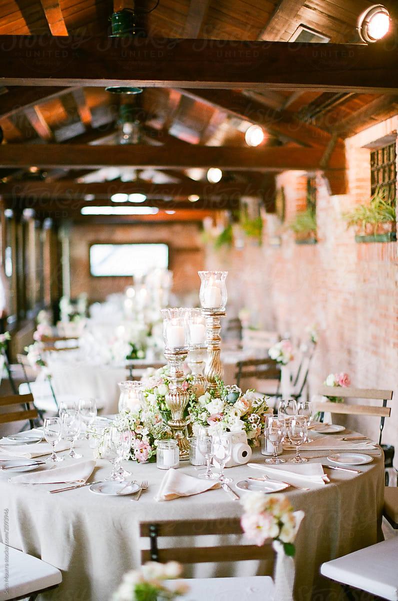 An elegant italian indoor wedding reception stocksy united an elegant italian indoor wedding reception by seth mourra for stocksy united junglespirit Choice Image